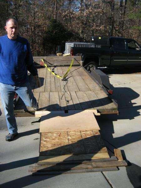 image: 3- wood placed on ramp to pull up pallet jack with press
