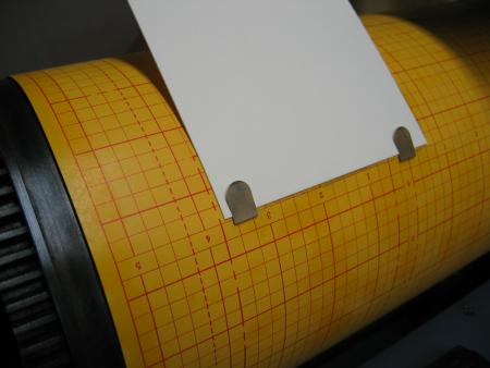 image: Tucking the Book Darts in slits in the graph paper, and tucking the printing paper in the Darts