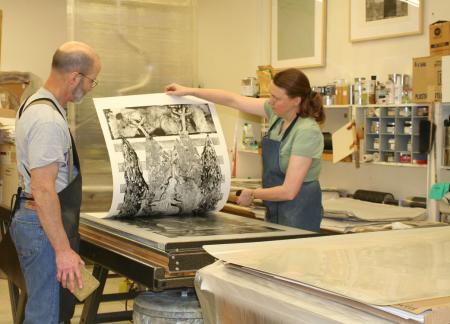 image: Richard Finch and Veda Rives pulling an impression during the printing of Geryon by Rudy Pozzatti.