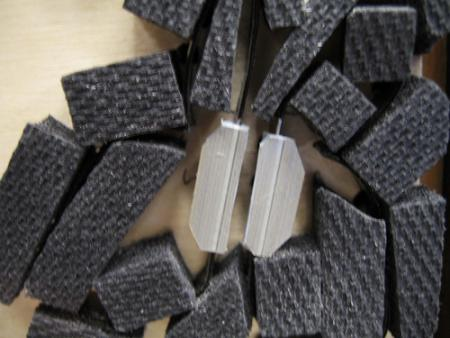 image: Moth steel rule die with plastic-back matrix applied (note mitered corners)