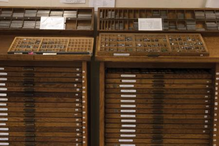 image: Type cabinets with cases in the SAIC shop.